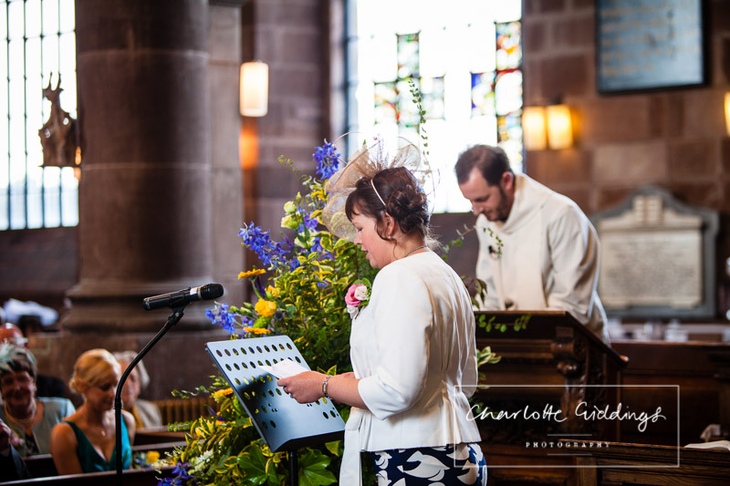 second wedding guest doing a reading at the front of church, wedding photographer shropshire