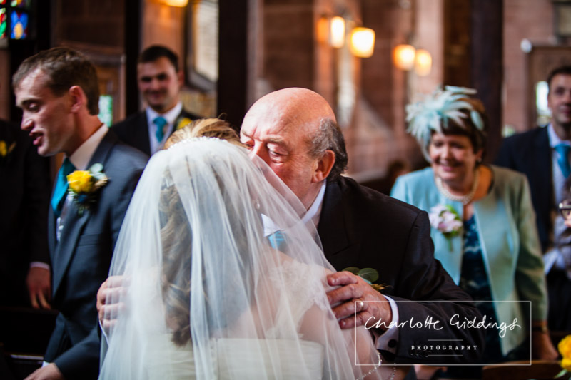 father of the groom congratulating the bride and kissing her - shropshire wedding photographer