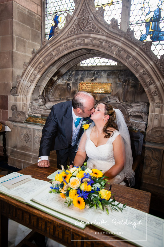 bride and groom kissing now offically mr and mrs after signing the registar