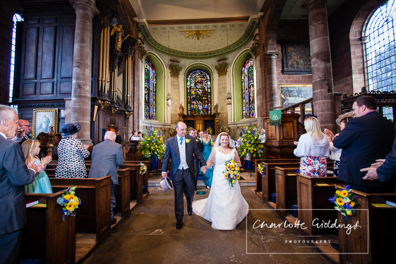 bride and groom walking down the aisle - st. alkunds church, whitchurch, shropshire