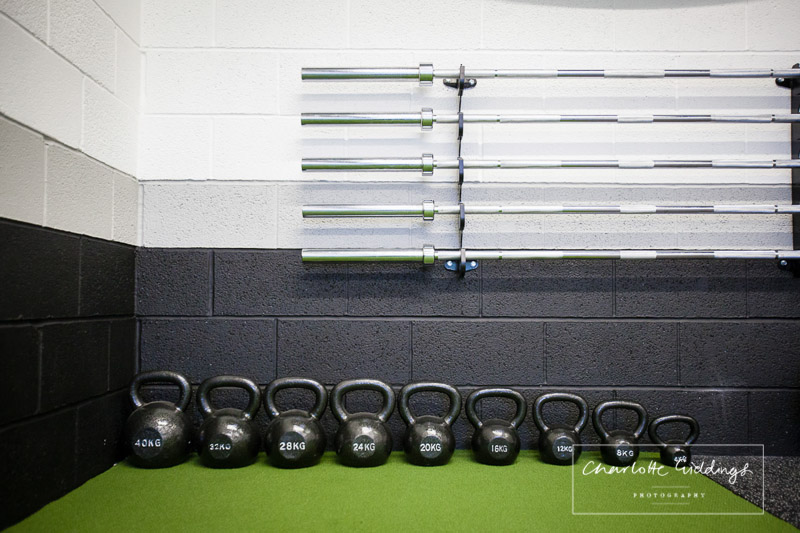 kettle bells and bar weights on display in order at mee-ft gym -shropshire photographer