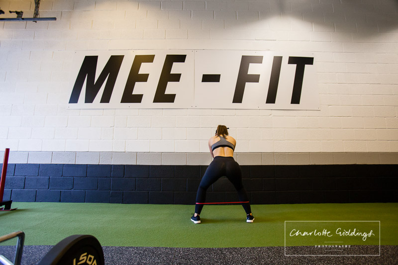 shannen at mee-fit doing resistance band side squats in the mee-fit gym whitchurch photographer
