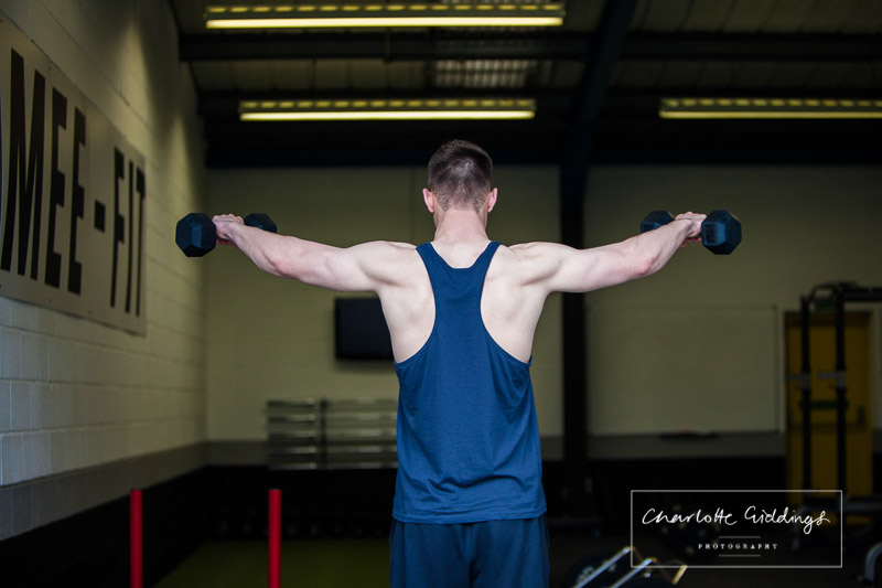 coach dans well defined back,shoulder and arm muslce, hard work does pay off- photographer whitchurch
