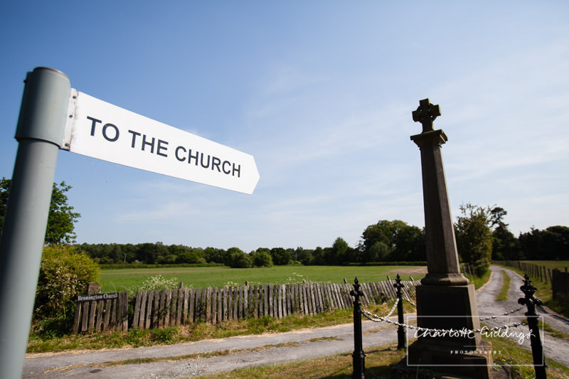 sign pointing to the church - bronington church, wedding photographer shropshire