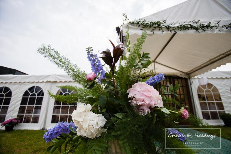 close shot of hydrangea flowers in milk churn - marquee wedding decor