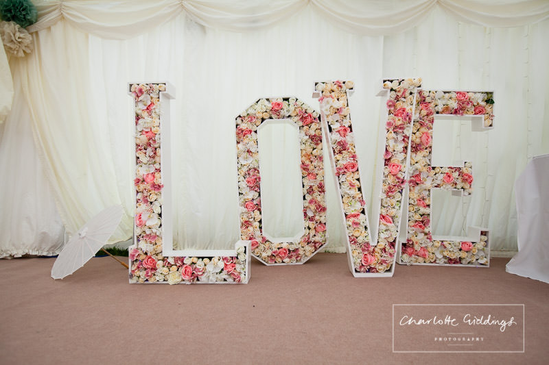 large love filled with flowers - marquee decor - wedding wales
