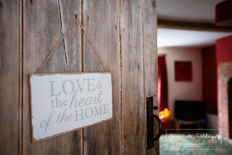 love is the heart of the home sign in bronington home - wedding photographer shropshire