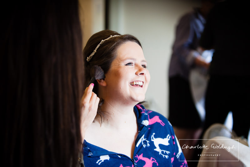 very happy bride having makeup and hair done by sophie bruno makeup artist - whitchurch photographer