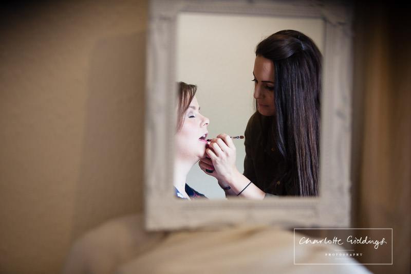 makeup artist doing brides lipstick - shropshire wedding photographer