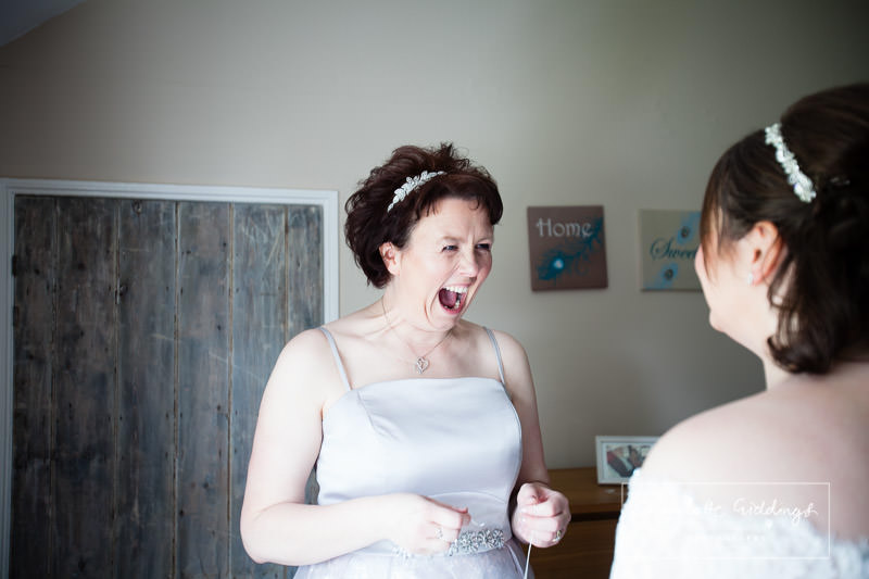 a super excited bridesmaid seeing her sister in her wedding dress - shropshire wedding photographer