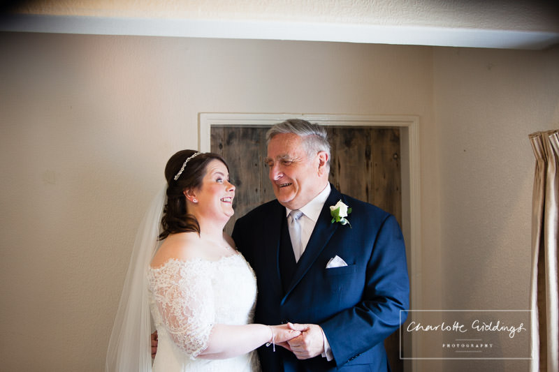 bride and father of the bride looking at one another - wedding photographer wales