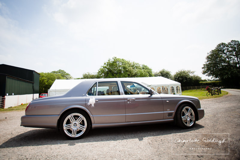 bentley wedding car outside front of bronington marquee wedding - charlotte giddings photography