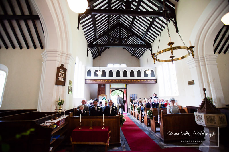 groom sat in the pugh in bronington church waiting for his bride