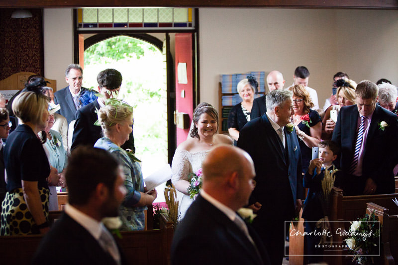 very excited bride to see the groom waiting in bronington church - charlotte giddings photography