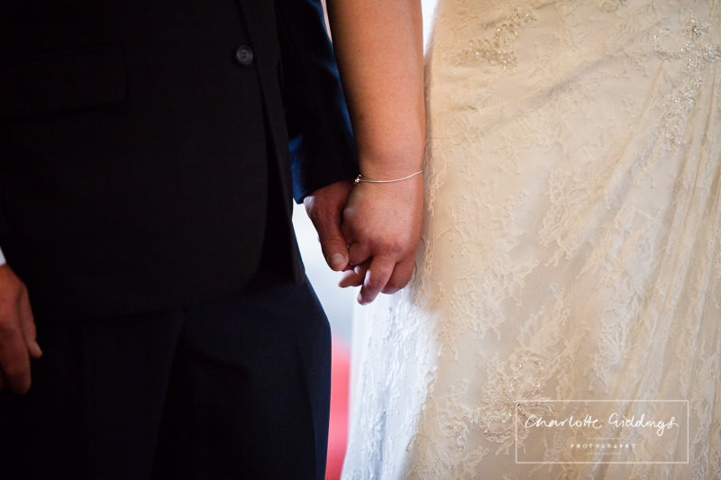 bride and groom holding hands in bronington church, wedding photographer, charlotte giddings photogarphy