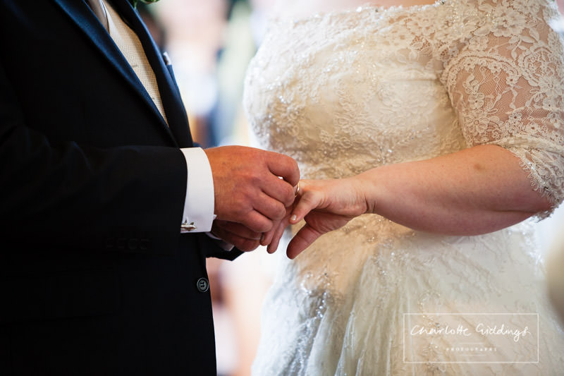 exchanging of rings in bronington church wedding service - charlotte giddings phot ography