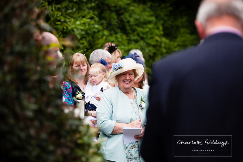 elderley relative excited to see the groom - candid shot outside bronington church