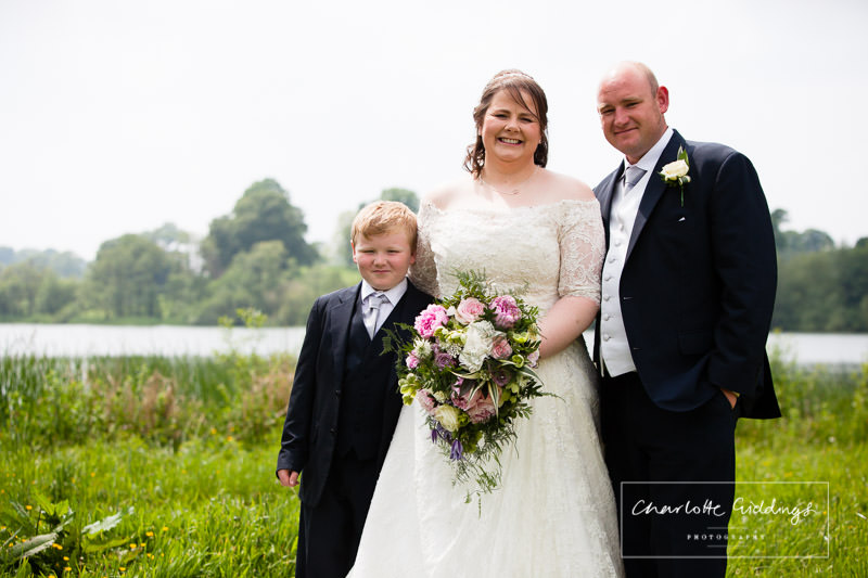 bride, groom and son portrait by hanmer mere - wales wedding photographer