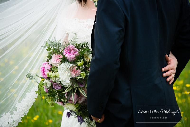 detail shot of the brides bouquet and arm around grooms waist 0 wedding photographer shropshire