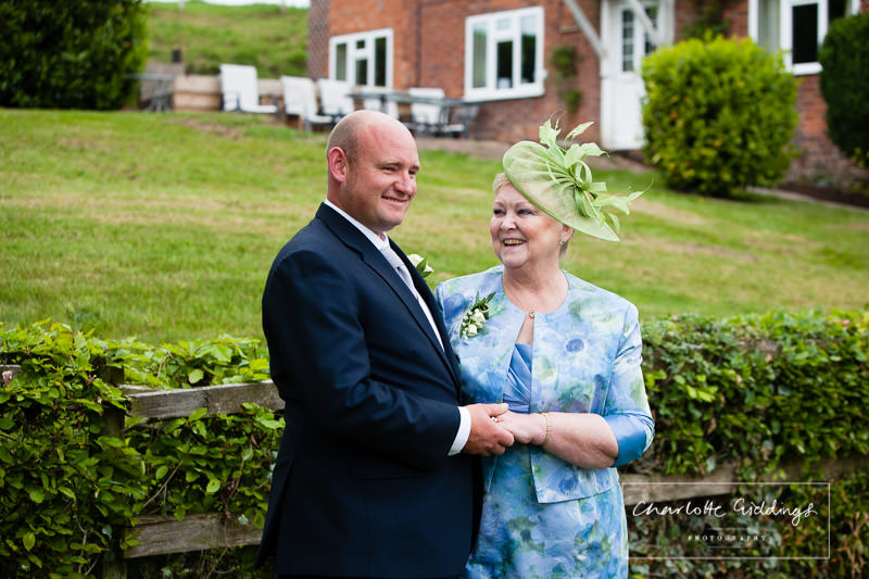 groom with his mum - candid photo - outside family home - bronington marquee wedding