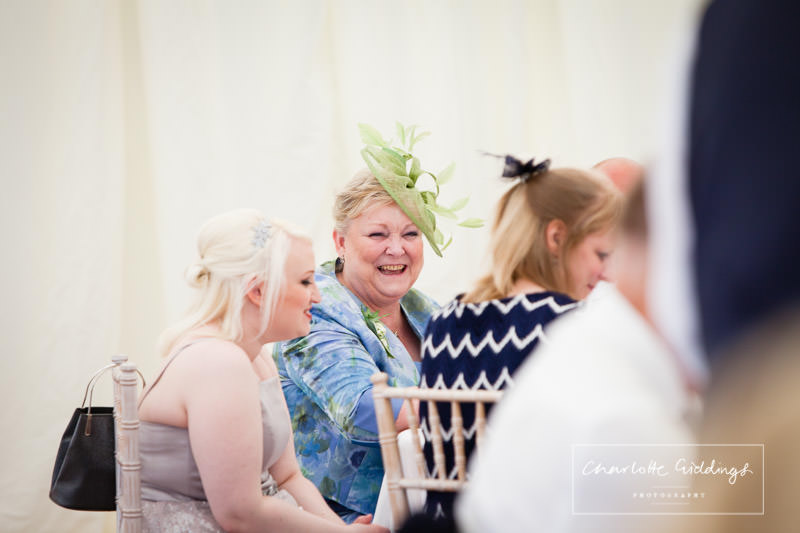mother of the groom laughing at father of the bride speech - shropshire wedding photographer