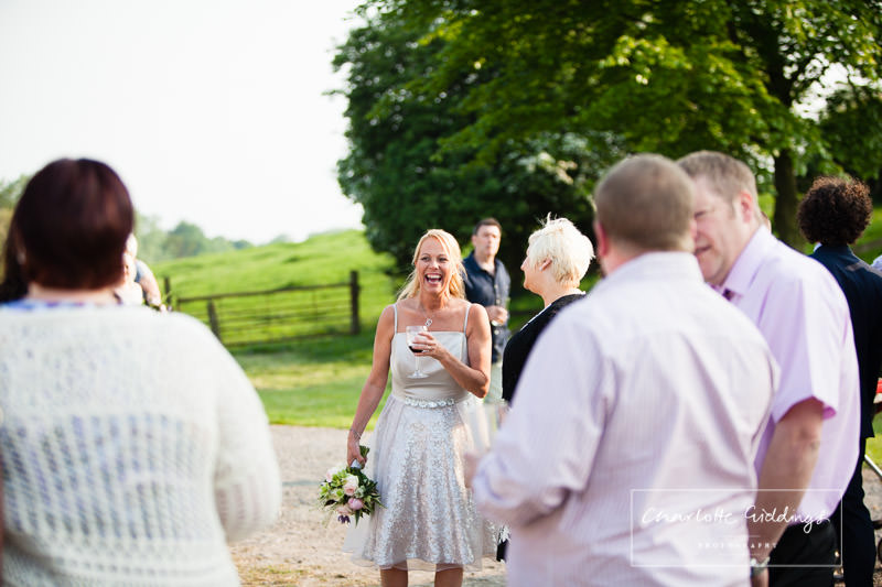 bridesmaid giggling outside on summer evening marquee wedding photographer