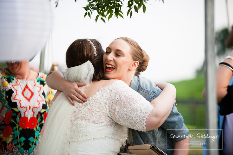 evening guest congratulating bride at marquee wedding wales
