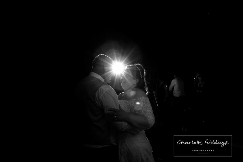 black and white photo of bride and groom doing first dance during marqu ee wedding wales