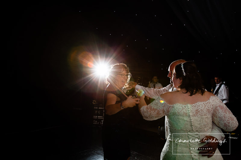 wedding guest joining in with first dance with bride and groom - wedding photographer shropshire
