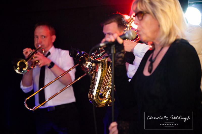 wedding band blozone in action at wedding venue bronington marquee photographer