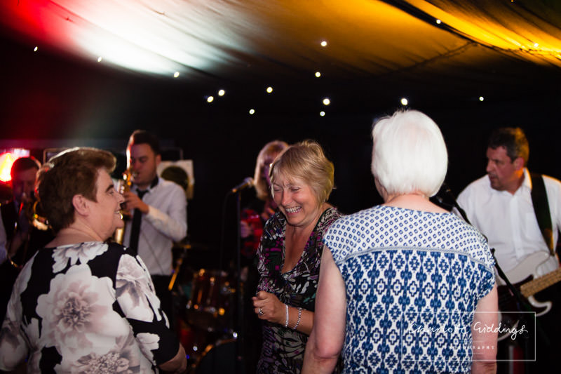 female guests dancing to the band - wedding photographer shropshire