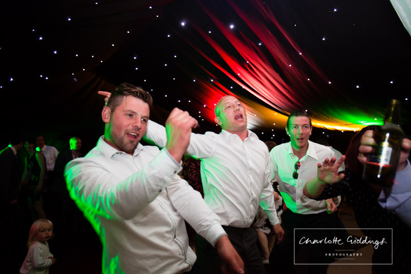 some of the boys - dancing really expressive faces - wedding photographer shropshire