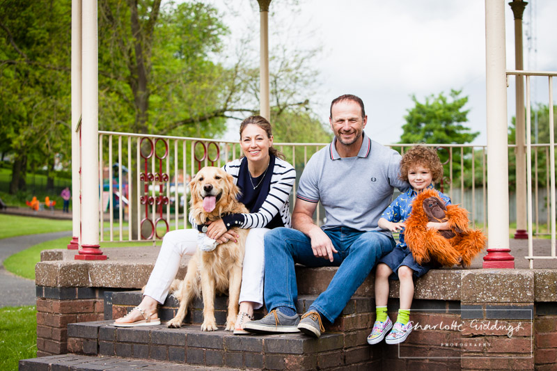 family photo fo mum and dad, little boy and goldren retriever with king louie jungle book - shropshire family photographer