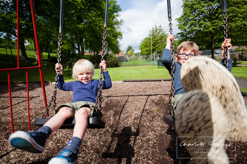 two brothers on the swings in jubilee park whitchurch - shropshire portrait photographer