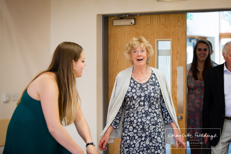 very surprised lady as she arrives for her 80th birthday party - mid wales photographer