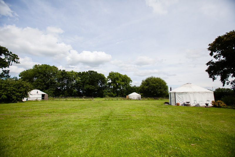 the three yurt in the field