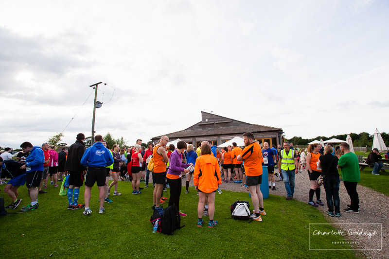 runners and supporters getting ready in front of dearnford lake's coffee shop