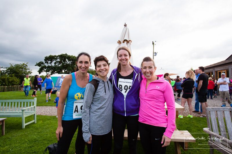 group of mum friends having a team photo before the dearnford lake grocontinental relay race begins