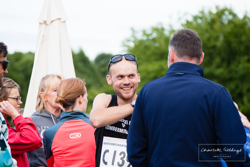 candid shot of one of the runners laughing before the event begins