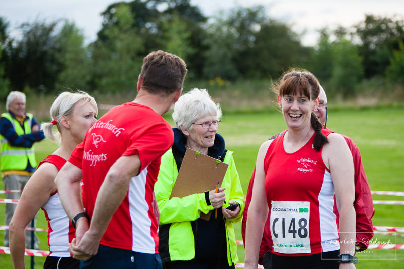 race organiser talking with a running club team just before the race at dearnford lake, whitchurch, shropshire