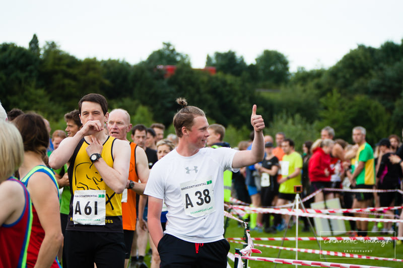runner at the start line giving supporters the thumbs up at dearnford lake relay