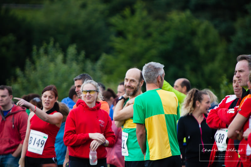 candid photo of a runner smiling on looking at the event about to begin - shropshire running event