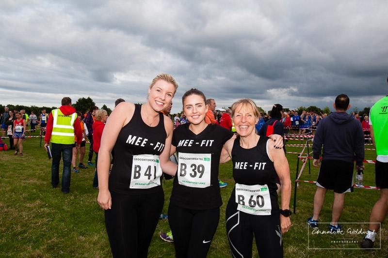 mee-fit ladies team photo in black club vests- charlotte giddings photography