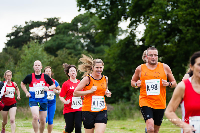 selection of shropshire running club members running the first leg of the relay event