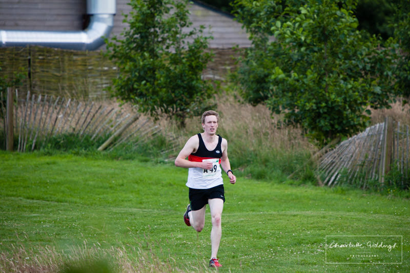 first male coming in to finish the first leg of the event at dearnford lake relay