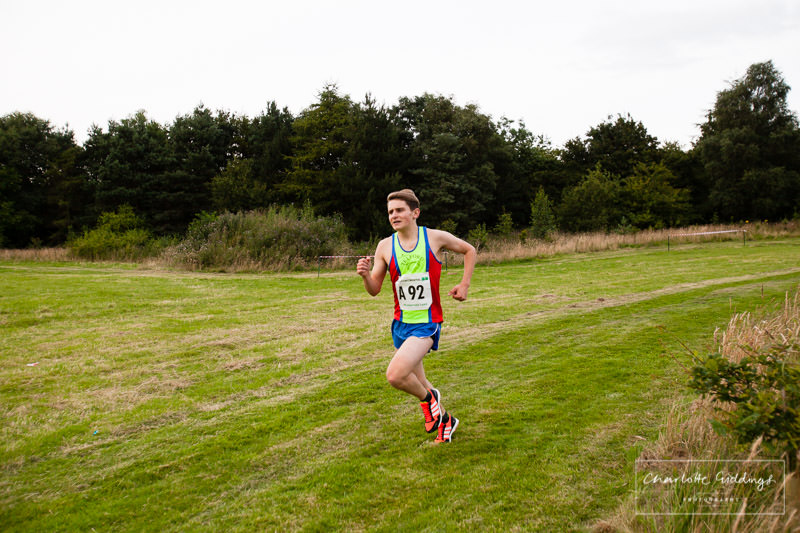 telford harrier junior on the home straight finishing the first relay leg for him team