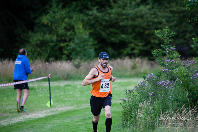 runner coming in on the last few hundred metres at the relay event, whitchurch shropshire