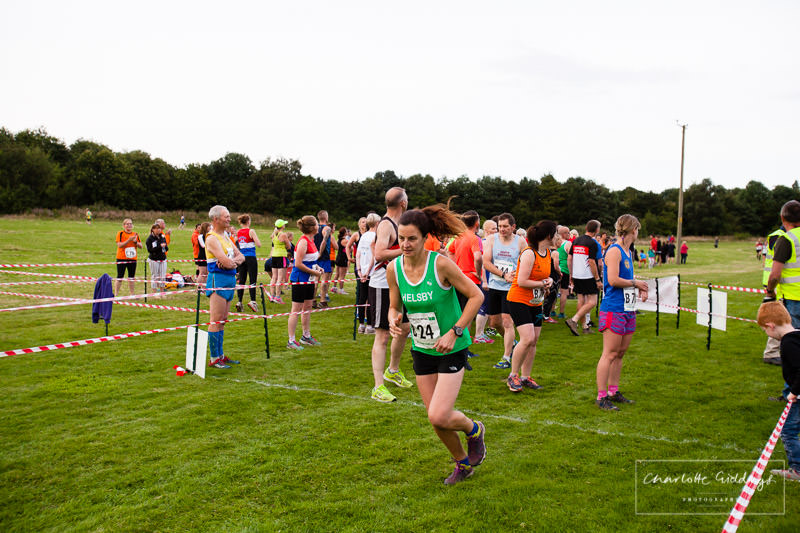 lady starting the second leg of the event for her team at dearnford lake relay