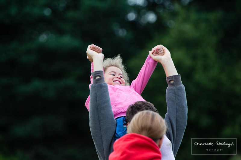 little girl having fun while sitting on someones shoulders at shropshire running event 2016