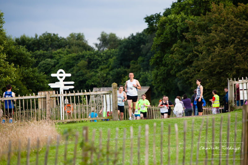 runners making their way to the finishing line with famous dearnfod lake landmark sign in the background